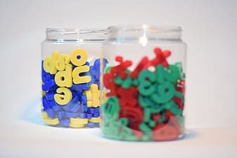 Two jars of numbers and letters