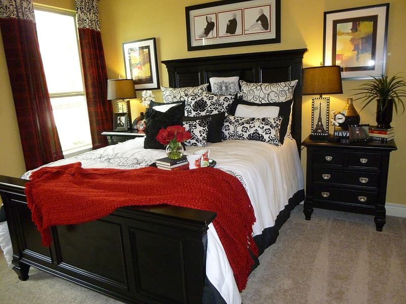 Black wood-frame bed and nightstand with drawers