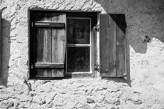 Grayscale photo of brown wooden cabinet