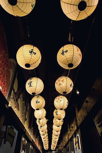 Paper lanterns with kanji texts on the street