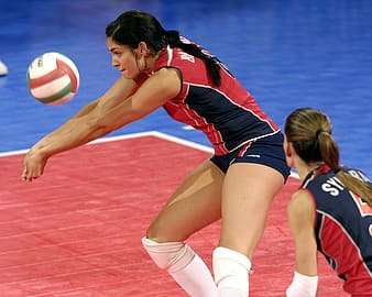 Woman in red and blue volleyball jersey