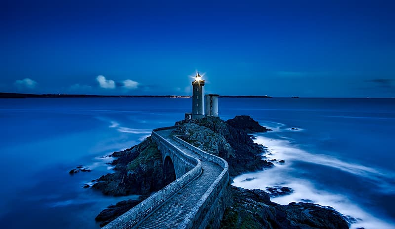 White and blue concrete house, photography of Rock Jetty with light house
