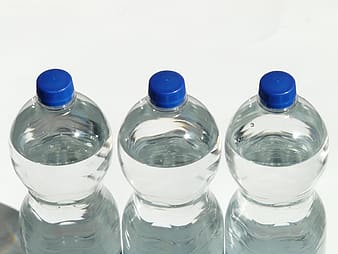 Shallow photography of three clear plastic bottles