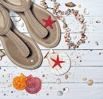 Pair of brown knitted sandals with assorted-color-and-shape seashells