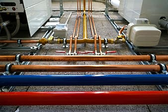 Focus photo of brown, blue, and red tubes