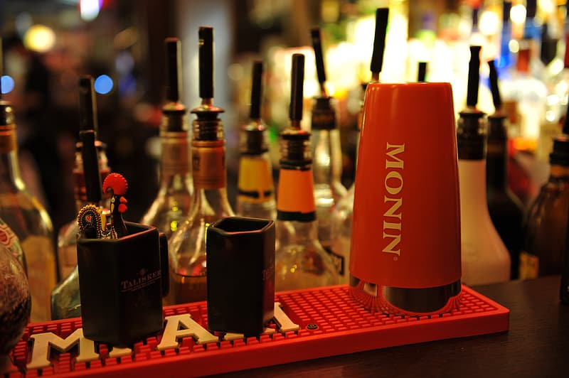Red Monin container on red plastic tray