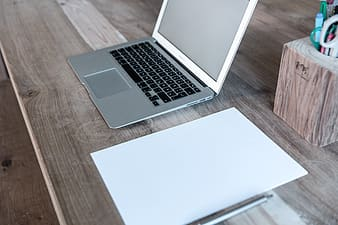 Macbook air on brown wooden table