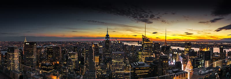 Aerial photography of city buildings during sunset