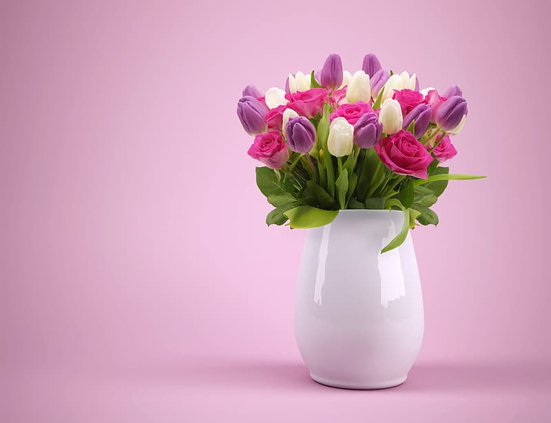 Bouquet of purple, pink, and white petaled flowers in white ceramic vase