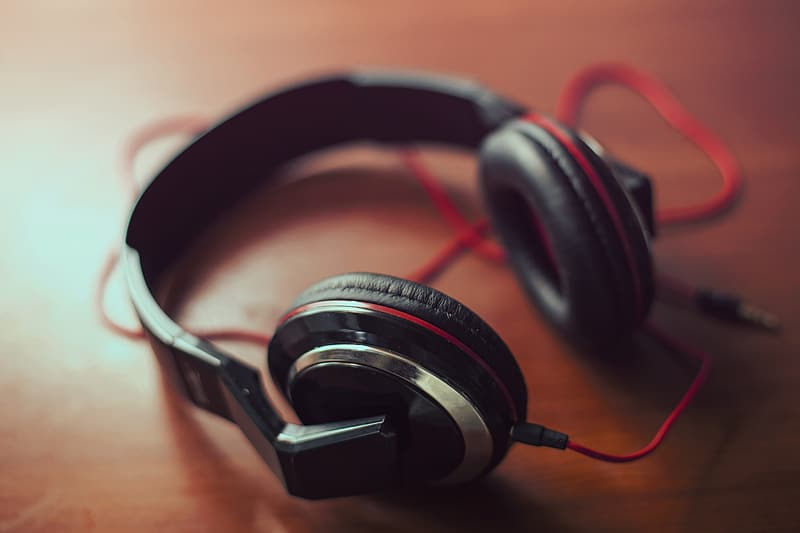 Shallow focus photography of black and red headphones