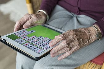 Person in green long sleeve shirt playing game
