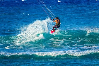 Person wakeboarding on sea