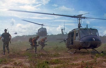 Soldier on field riding on helicopter