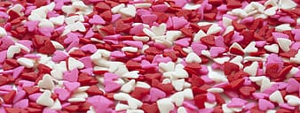 Pink and white heart shaped candies