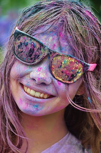 Woman with assorted color paints on face