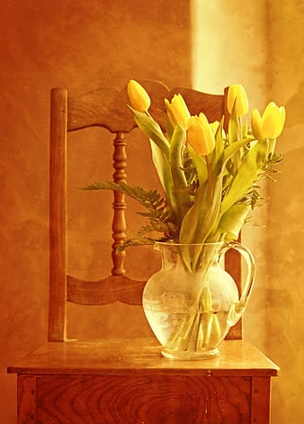 Clear glass pitcher with flowers