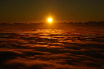 Yellow sun on sea of clouds