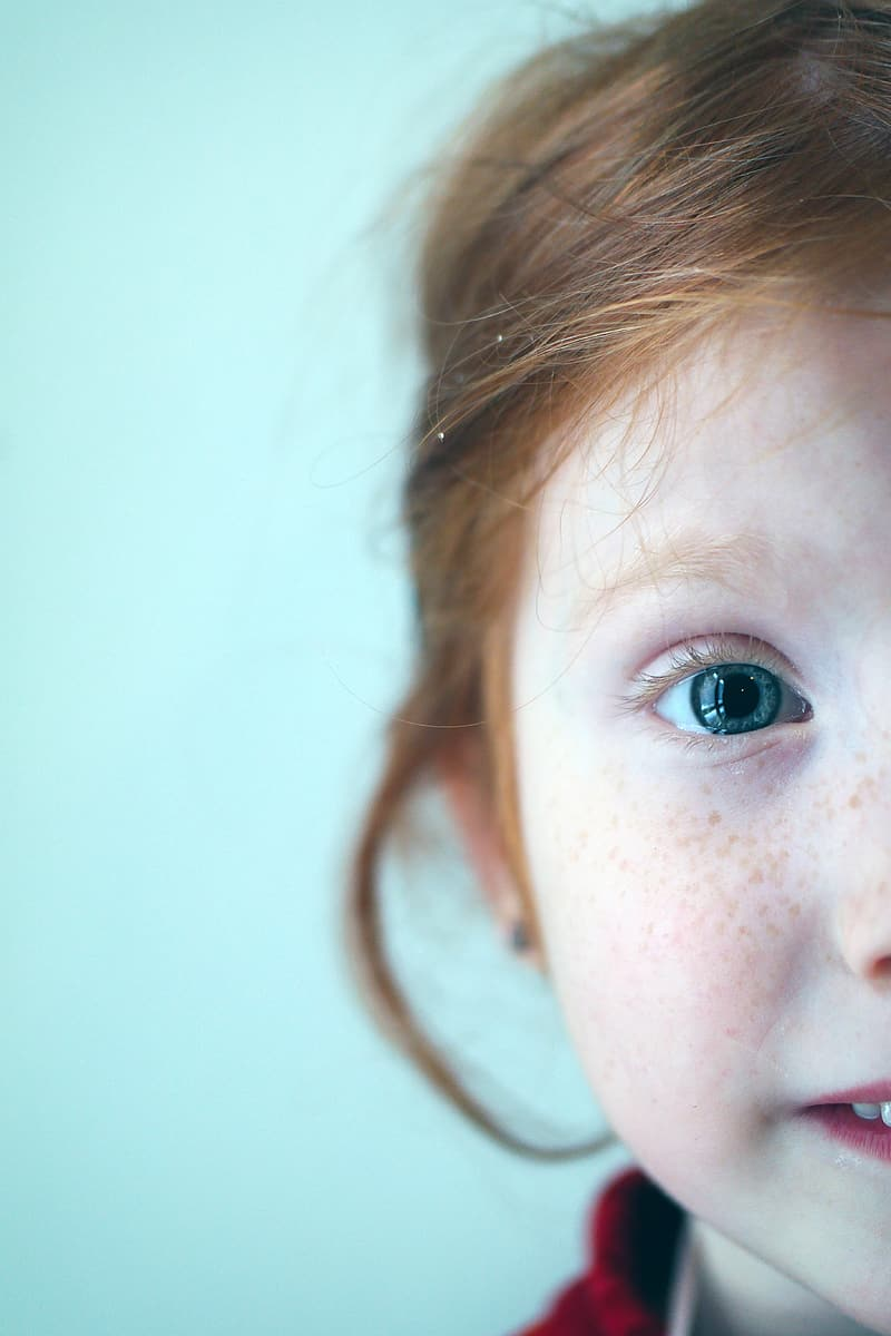 Selective focus photography of girl's face