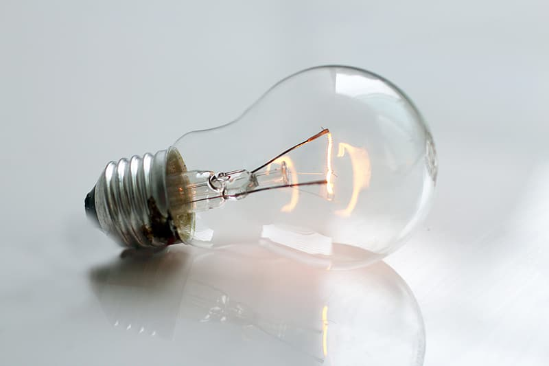 Clear light bulb on top white surface