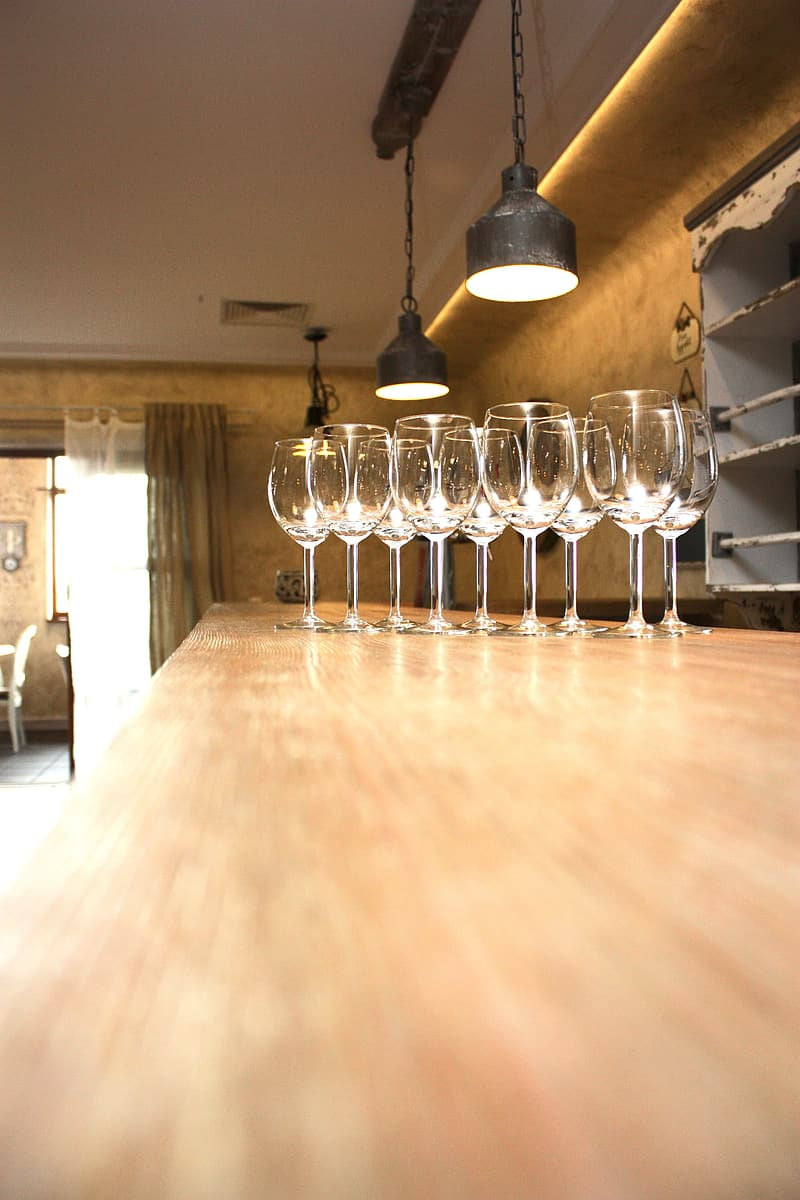 Clear wineglasses on brown wooden table