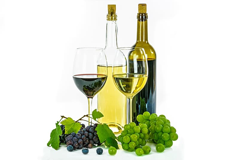 Two clear glass bottles and wine glasses