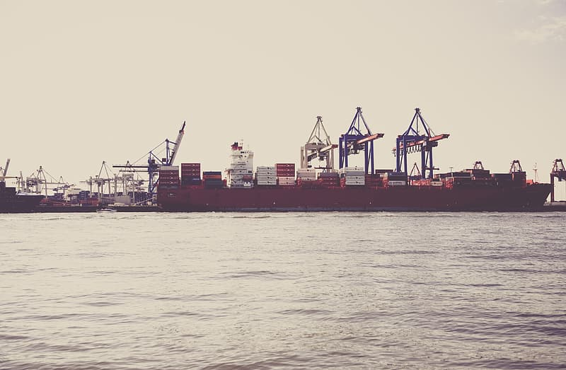 Shipping container on red boat