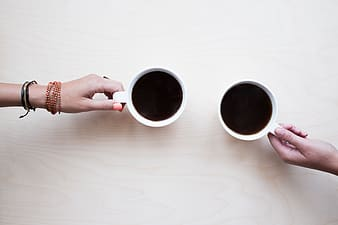 Two white ceramic coffee cups