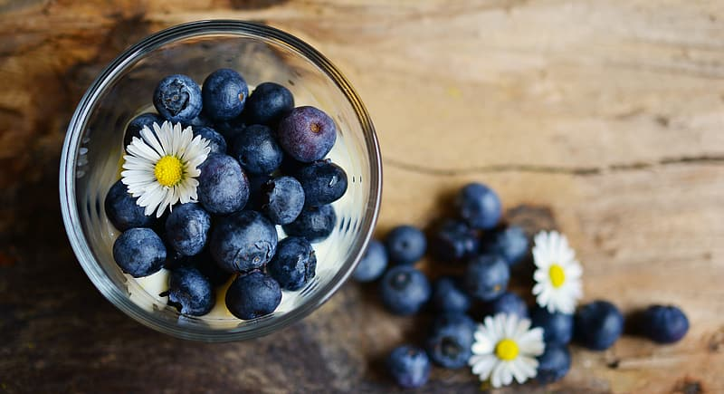 Blue berries in glass cup