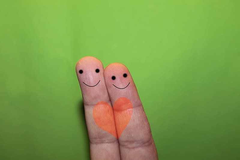 Two fingers drawing emoticon
