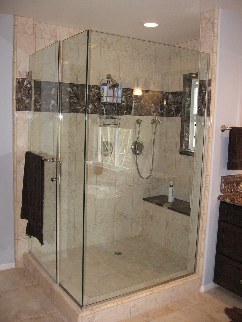 Clear glass shower stall with stainless steel shower head
