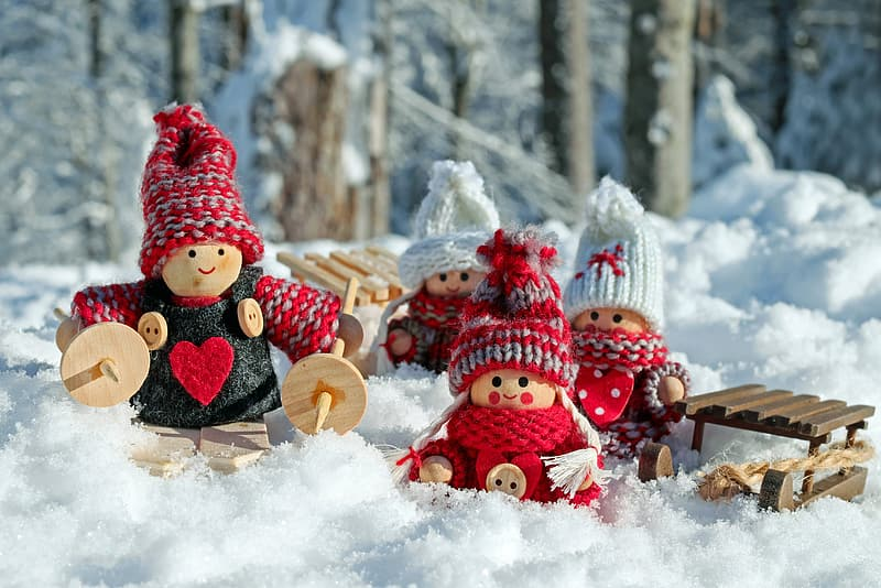 Wooden dolls on snow-covered ground