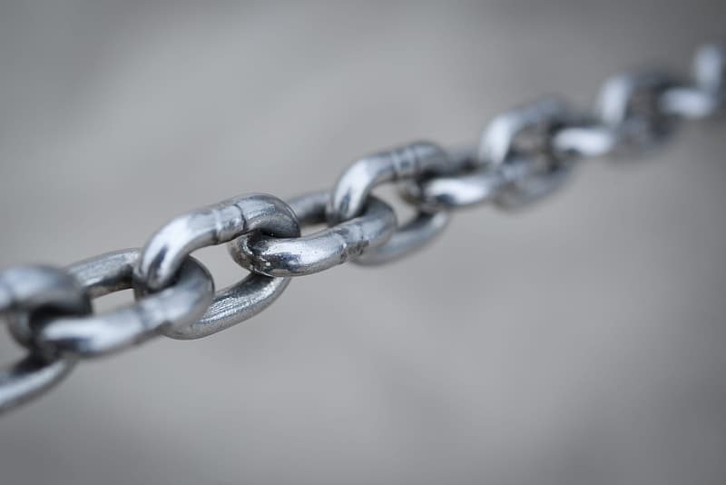 Grey metal chain in close up photography