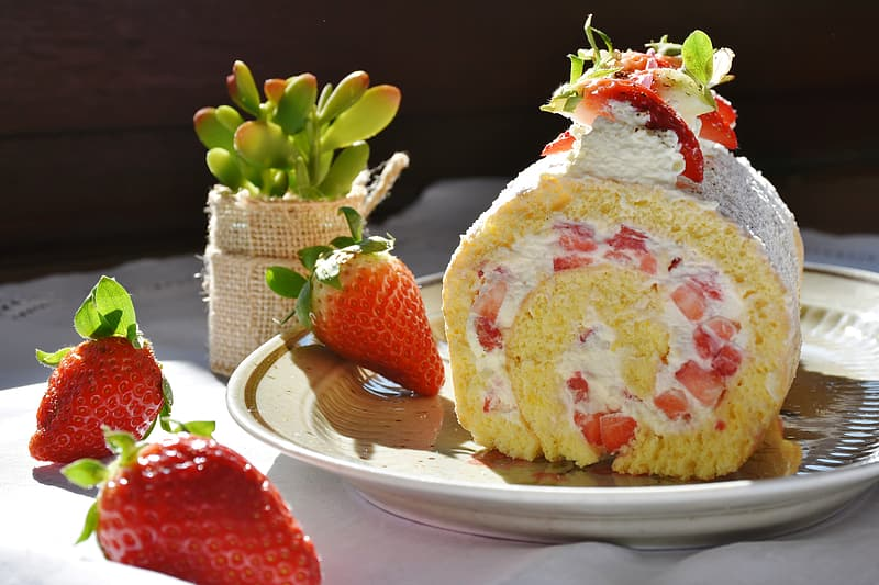 Cake served in plate with strawberry