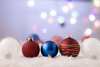 Red and blue baubles on white snow