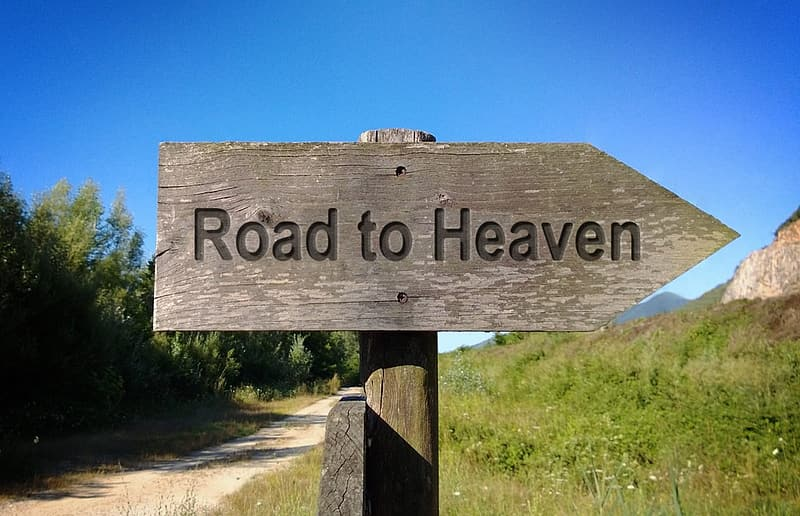 Grey wooden Road to Heaven signage