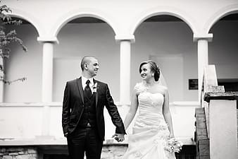 Grayscale photography of newlywed couple
