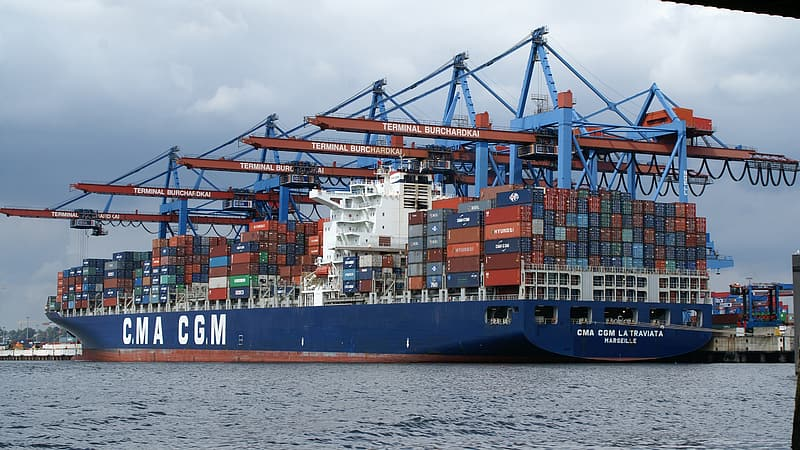 Blue cargo ship on body of water