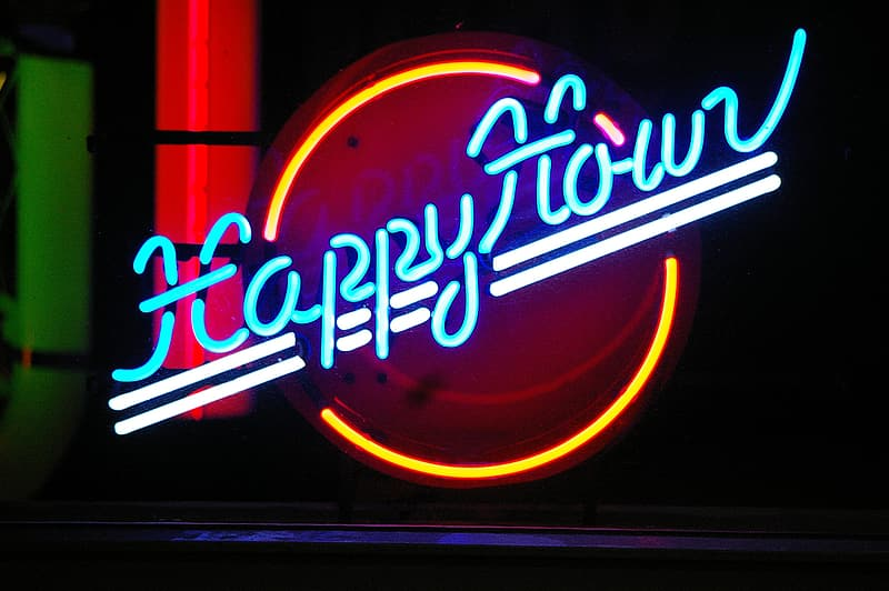 Blue, yellow, and white Happy Hour neon sign