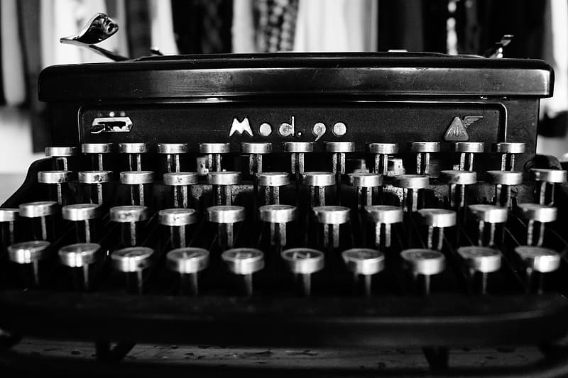 Grayscale photography of typewriter