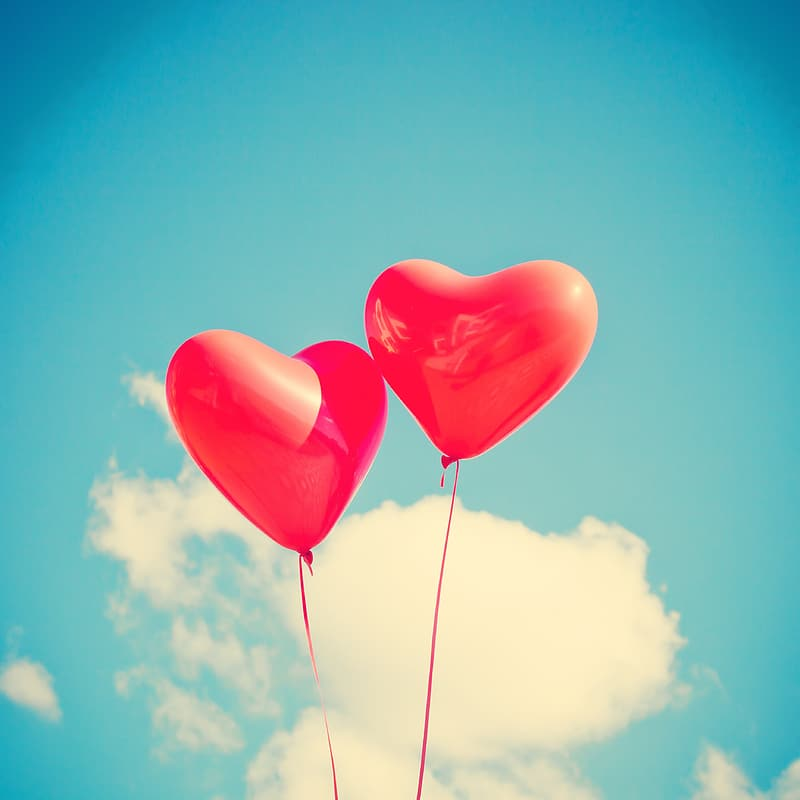 Two red heart balloons