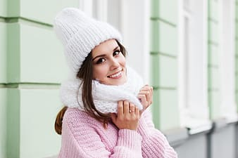 Woman in white knit cap and pink sweater
