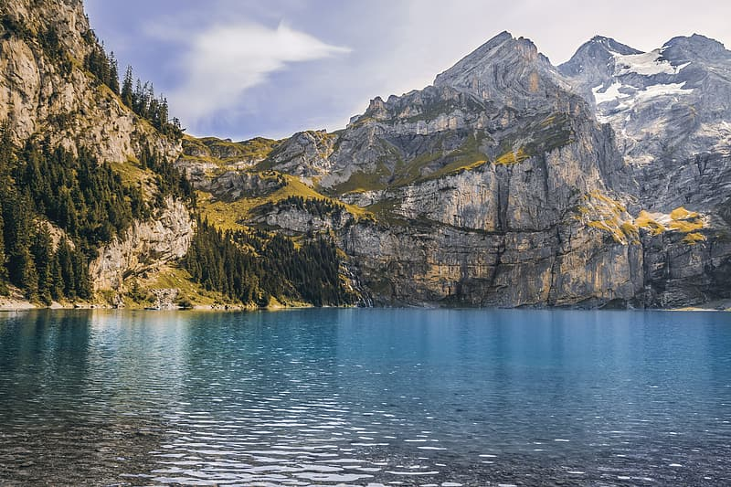 Gray mountain and body of water photography