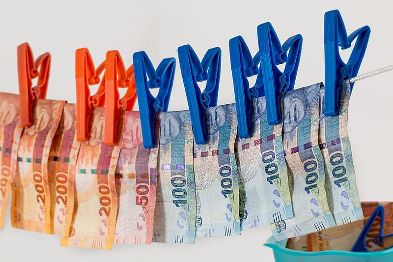 Banknotes hanging on clothes line