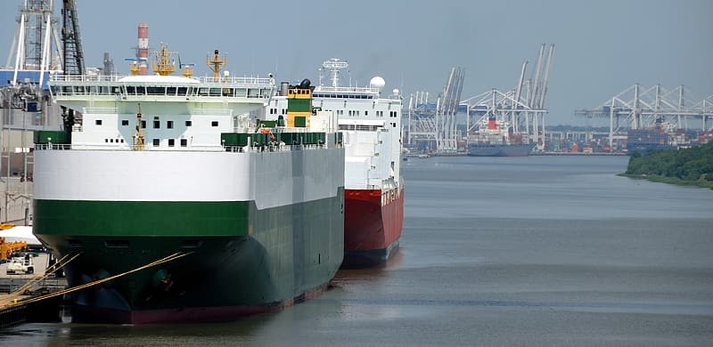 Ships on body of water beside dock during daytime photo