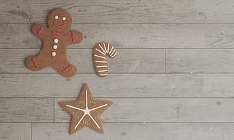 Gingerbread, cane, and star cookies on floor