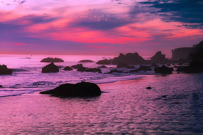 Silhouette of rock and sea
