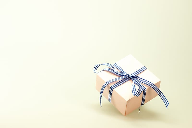 Beige gift box with black and white ribbon