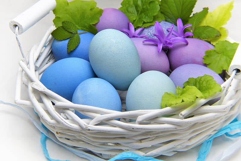 Basket of blue and purple easter eggs