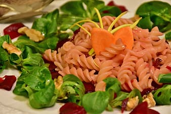 Close-up photography of swirl pasta with vegetables