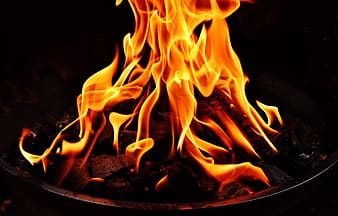 Flame on black fire pit